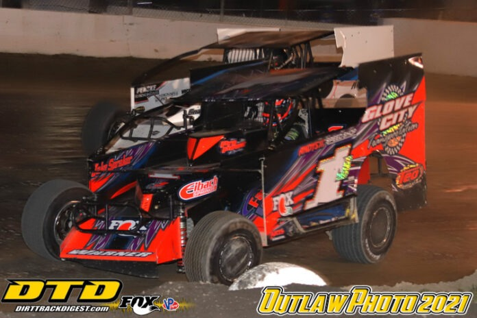 Rocky Warner holds off Ronnie Johnson